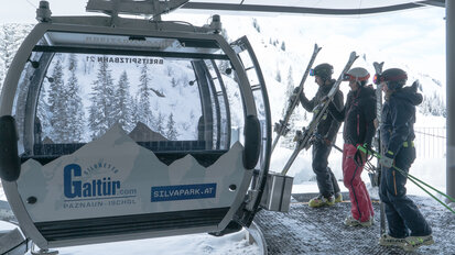 Skiers get ready for their skiing experience by entering the gondola of Galtür