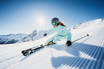 Skier enjoys the skiing experience in the Silvapark Galtür in sunshine