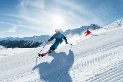 Skiers spend their days on the slopes of Galtür with sunshine