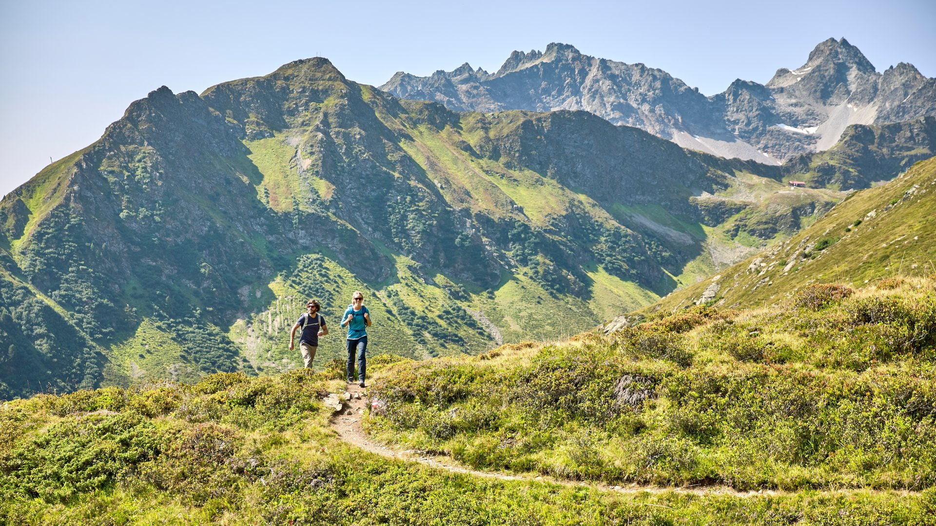 Holidaymakers enjoy the hiking trails in the mountain landscape Kappl